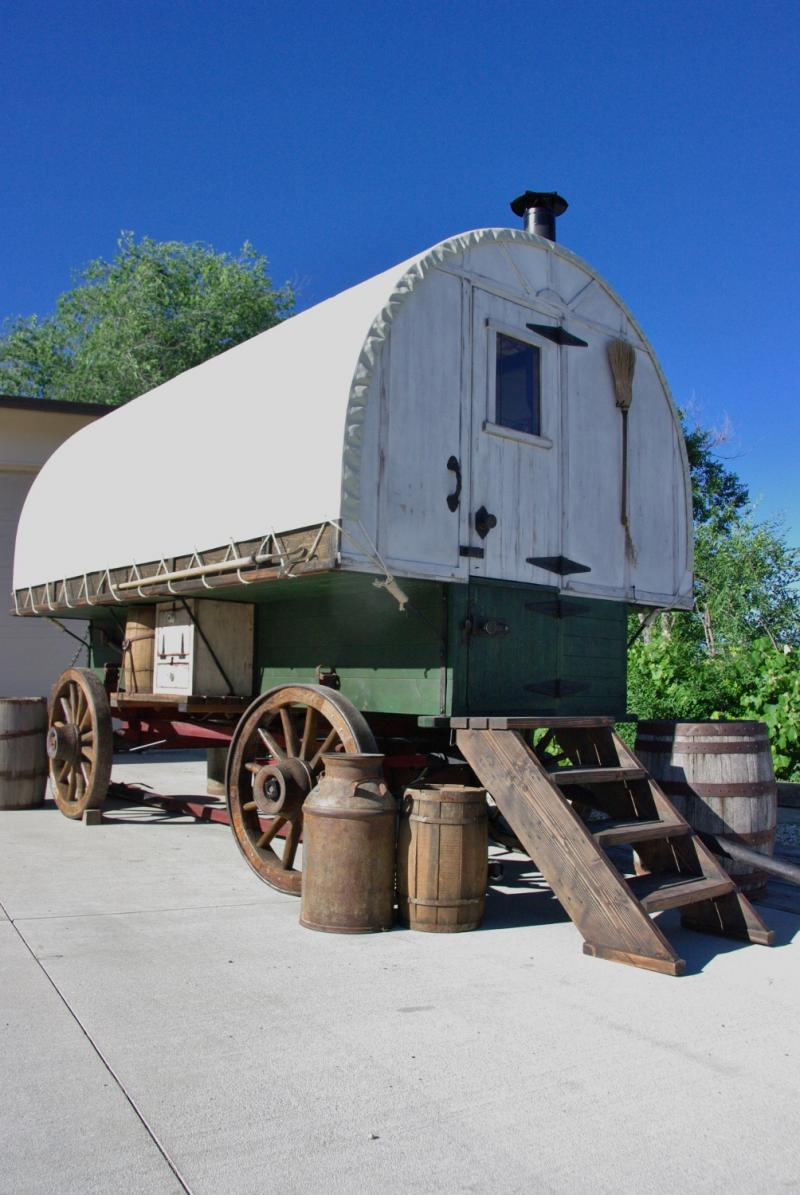 This Sheep Wagon was built on old running gear we restored , colors were chosen